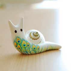 Hand-painted Snail with shell by JooJoo. Super Cute. http://www.flickr.com/photos/etsyjoojoo/sets/72157616223590925/