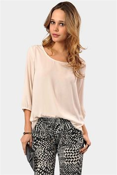 Simple cream top and black print pants. Love this outfit