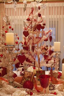 Red goblets bring the color up from the flat place setting to the taller centerpiece...