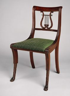 Duncan Phyfe side chair, early 1800's. Phyfe immigrated from Scotland and blended English Neoclassical and Regency styles, supplying furniture to the wealthy families of New York.