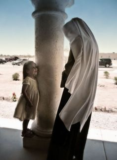 Poor Clares. I love this photo! I like to think that little girl will always remember her encounter with the nun. ~ dw