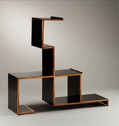 Eugene Schoen, Étagère, 1929. Chestnut, Bakelit & Bronze. Via metmuseum.org  New York born Schoen went to Vienna in the early 1900s to study architecture with Otto Wagner and Josef Hoffmann. His furniture designs reflect the influence of the French avant-garde style, but his use of new materials such as Fabrikoid, Flexwood, and Monel combined with luxurious materials of the Art Déco period make the objects uniquely his own.
