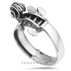 This ring takes its artistic form from a cello. The scrollwork on the head and fingerboard are exactly to proportion. The perfect ring for your bowed instrument lover.