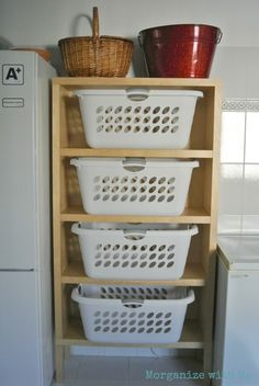 Organized Reader's Laundry Room with a tower for laundry baskets! Organized Reader's Laundry Room with a tower for laundry baskets! Laundry Room Baskets, Laundry Basket Storage, Laundry Room Doors, Laundry Room Cabinets, Storage Tubs, Laundry Area, Small Laundry, Plastic Storage, Storage Shelves