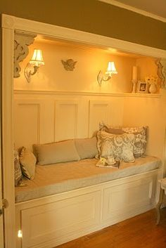 Closet-turned-reading nook. Is stay here forever.  If I could lock myself in....