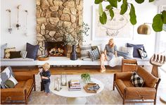 Good Housekeeping Home Tour - Emily Henderson... white walls, caramel, navy, olive green, black accessories