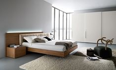 Wonderful bedroom design interior with floating bed design and white fur rug as well large white wardrobe