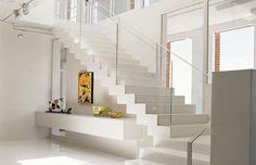 Een open trap wordt steeds populairder. Zorg er wél voor dat er door het ontbreken van stootborden niet teveel warmte verloren gaat