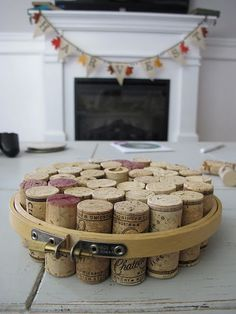 DIY: a trivet made from wine corks and an embroidery hoop (you could also use a metal hose clamp too)! Just another great use for all those corks and another excuse to drink more wine!