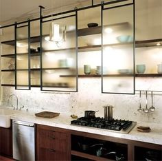 What a great concept for kitchen upper cabinets the sliding glass barn door hardware and frosted glass play well together in a contemporary kitchen planetlyrics Image collections