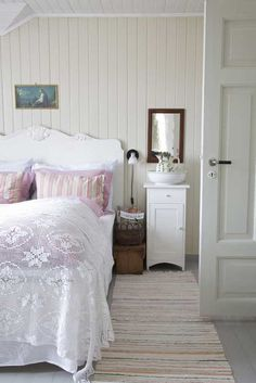 farmhouse style bedroom----love the painted wood walls