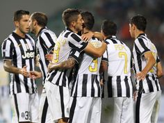 Roberto Pereyra with his teammates of FC Juventus celebrates after...