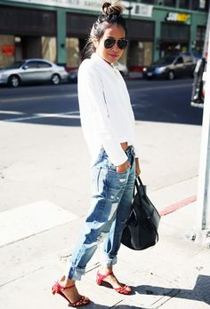 Julia Sariñana of Sincerely Jules wears a button-down blouse, boyfriend jeans, Mary-Jane embellished heels, a black Céline tote, and aviator sunglasses