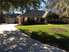 980 Lakeridge Drive #OrangePark, #FL 32065  Outstanding 2730 sq. ft. brick pool home with remodeled kitchen and incredible attached workshop. This 4 bedroom, 2 ½ bath home in Foxridge subdivision comes with hills and mature trees. View the large salt-water, palm-lined pool from the two walls of windows in the beautiful sunroom. Sunroom has gorgeous Brazilian Cherry floors, coffered ceilings, and 3M solar and security film.  #Florida #RealEstate