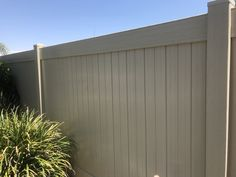 Tan embossed Vinyl Fence installed by Fence. Great option for those who do not like the shine on standard whit or tan vinyl fence. Embossing gives you a wood grain finish.