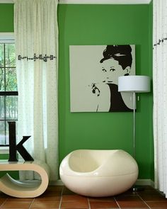 Love this green wall color paired with black and white! (Side note: also <3 Audrey Hepburn!)