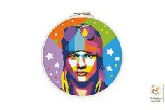 "Colorful Axl Rose cross stitch pattern, Guns N Roses cross stitch, Famouse people cross stitch, Pop art xstitch, Abstract singer portrait chart, Geometric rock star ★★★ Pattern details★★★ DMC colors: 16 154 stitches wide X 154 stitches high Aida 14: 11.0"" X 11.0"" (28.0 X 28.0 cm) Aida 16: 9.6"" X Star Patterns, Color Patterns, Cross Stitch Patterns, Axl Rose, Guns N Roses, Floral Logo, Cross Stitch Rose, White Crosses, Modern Embroidery"