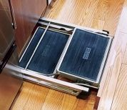 When not needed for added height, this collapsible stepladder stashes behind a toekick panel.