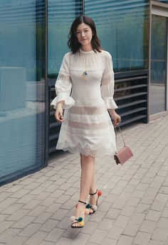 Actress Michelle Chen wore in SHIATZYCHEN 2017FW collection white lace chiffon dress for a street snap.