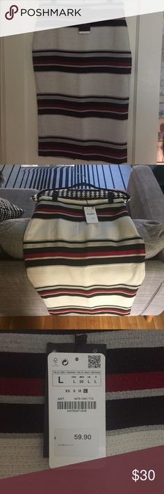 Black, grey, red, and white striped Zara skirt This is a midi-length, fitted Zara pencil skirt. It is an acrylic material - meant to look a little like wool. Definitely a fall item. Has a back zip, size L, NWT. Zara Skirts Midi