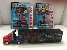 The same Optimus Prime die cast Truck 3 ways... (light up, regular, with trailer). Purchased October/November 2016.
