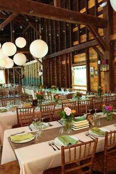 DAWN:  love the crispness and brightness.  long tables 5 chairs per side.  3 table arrangements.  runner down center of table.  no books.