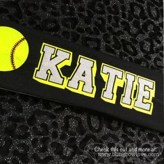 Cotton stretch headband with custom name and softball. Name is in white glitter…