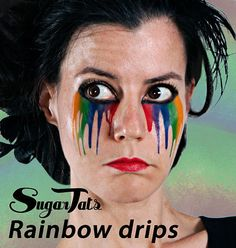 Thess trippy rainbow tear streaks. | 23 Temporary Tattoos That Make Halloween Makeup Easy