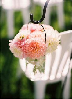 hanging mason jars with pink and white florals down the aisle