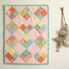 love the simple quilting on the solid blocks - great scrap quilt