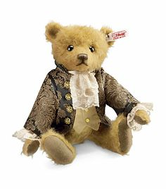 Steiff Sir Edward Teddy Bear Sir Edward is a handsome fellow, straight out of the baroque era. Made in Germany by Steiff from the finest golden mohair, he comes dressed in a jacquard manorial coat, silk dupion waistcoat and a handmade lace jabot. His paws are crafted in the finest felt and his face is adorned with a hand stitched nose and mouth and black beaded eyes. Limited edition, only 1,500 Sir Edward bears are available worldwide.