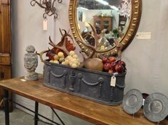 Fill antique planter (or a new one) with gourds, antlers, mid-century stone grape cluster, pine cones...