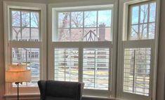 Half-length plantation shutters in living room bay window.