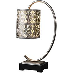 @Overstock - The round drum shade is stamped metal finished in a lightly antiqued silver leaf with a mica liner   Setting: Indoor  Fixture finish: Lightly antiqued silver leaf with a matte black foot  http://www.overstock.com/Home-Garden/Faleria-Table-Lamp/6303700/product.html?CID=214117 $162.80