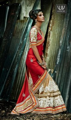 Beige and Red Bamberg Jacquard and Net designer saree Beige and red bamberg jacquard and net designer saree.This saree is covered with multi Color & stone lace work with two side pipping and floral embroidery work at lower part with stone worked at pallu.