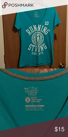 Nike Top Beautiful blue v-neck the, New!! Slim fit, 100% cotton. Never worn. Nike Tops