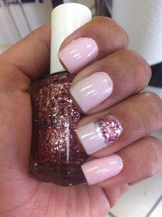 Pink polish with glitter design. Fun nail art