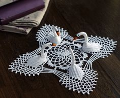 "4 swan crochet doily - pretty sure I've seen this in one of Mum's old crochet booklets.  It must have been ""too hard""."