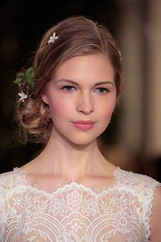 Delicate floral hair accessories and a low, loose bun at the Carolina Herrera Bridal Spring 2016 show // Wedding Hair and Makeup Ideas From Bridal Fashion Week