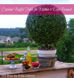 Create a Beautiful Outdoor Buffet Tablescape with Boxwood Topiaries by 504 Main