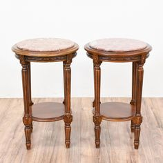 This pair of 2 tiered end tables are featured in a solid wood with a glossy light cherry finish and intricate carved details. These neoclassical side tables are in great condition with 2 round tiers, tapered legs with fluting and pink marble top!   #neoclassical #tables #endtable #sandiegovintage #vintagefurniture