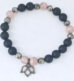 Sunstone, Matte Black Onyx and Pyrite Bracelet with Lotus Charm handcrafted from Healing Crystal beads and a Pewter Lotus charm on elastic cord by Soul Sisters Designs