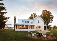 Backyard.+Farmhouse+Backyard.+Adirondack+chairs,+backyard+firepit+,chimney+pipe,+metal+roof,+stone+chimney,+white+house,+white+siding