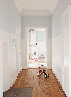 love the high wainscoting and the warm pale blue walls above. Makes a living space airy and filled with light - something Scandinavians strive for in a dark climate! Hall Colour, Hallway Colours, Picture Rail, Paint Colors For Home, Home Decor Inspiration, Interior Design Living Room, Ideal Home, Decoration, Sweet Home
