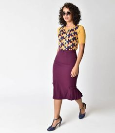 Deep eggplant purple weave, this radiantly resilient skirt is banded high waist is notched at the center, dotted with faux button detail and outfitted with a hidden side zipper and divine dart