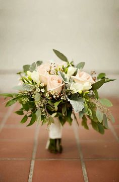 Hand Tied Wedding Bouquet Which Includes: Champagne/Blush Roses, White Wax Flower, Dusty Miller, Green Seeded Eucalyptus + Several Additional Varieties Of Greenery & Foliage >>>>