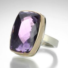 This Jamie Joseph ring exudes a feeling of luxury with it's rich purple color and impeccable faceting.