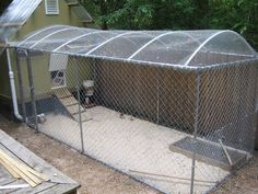 Chicken Coop Ideas. I like the way they handled the run top.