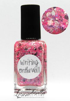 Lynnderella Limited Edition —  Writing on the Wall has assorted pink, white and black glitters in a pink-shimmered clear base.