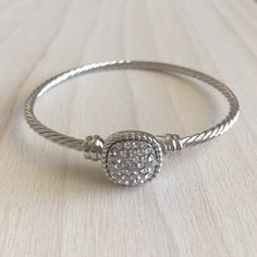 Silver Bangle With Crystal Square Brand new! For small wrist. 2.25 inch diameter. Jewelry Bracelets